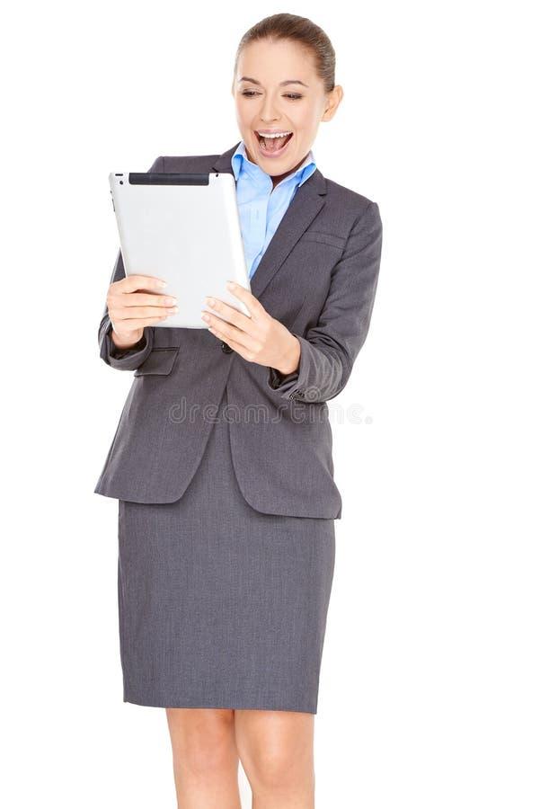 Empresaria emocionada con una tableta - PC fotos de archivo