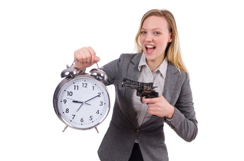 Empresaria en el traje gris que sostiene el despertador imagenes de archivo