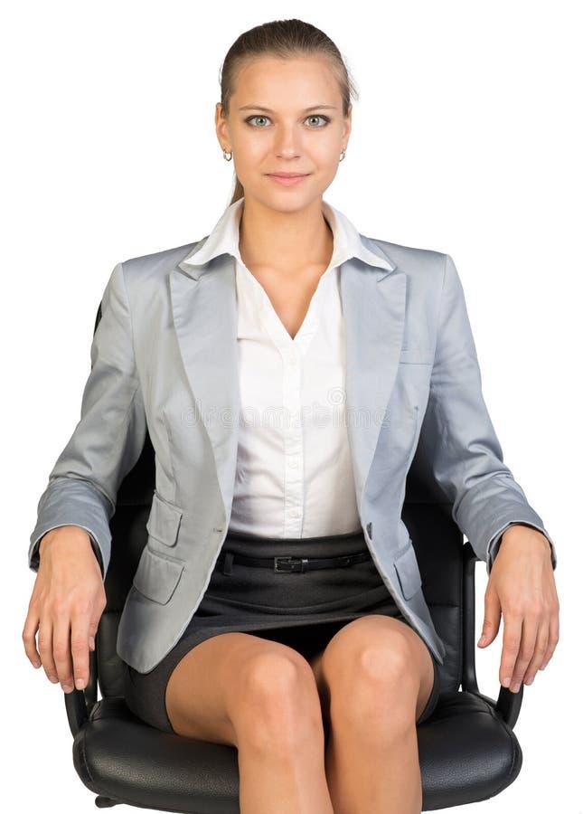 Empresaria en silla de la oficina fotografía de archivo