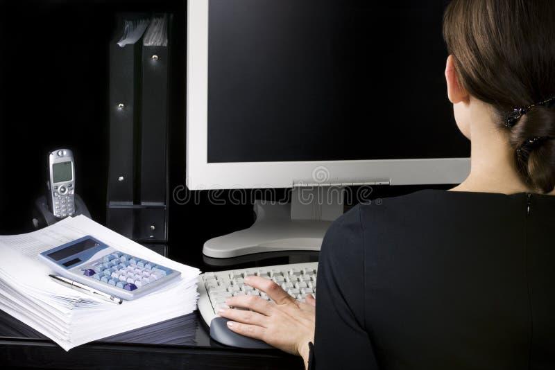 Empresaria en su lugar de trabajo fotografía de archivo