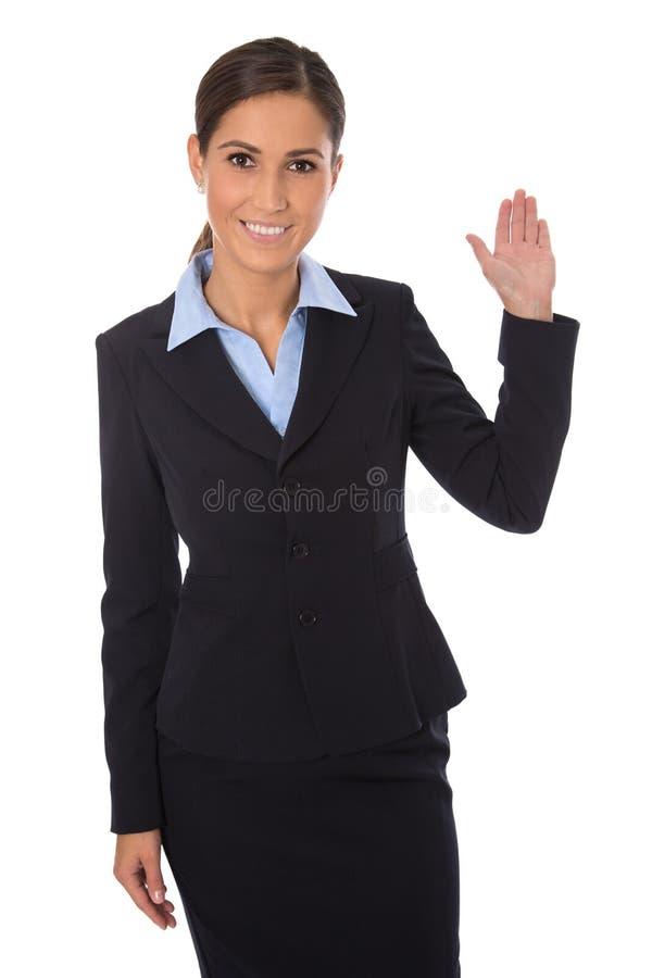 Empresaria feliz aislada que presenta y que muestra sobre b blanco foto de archivo libre de regalías
