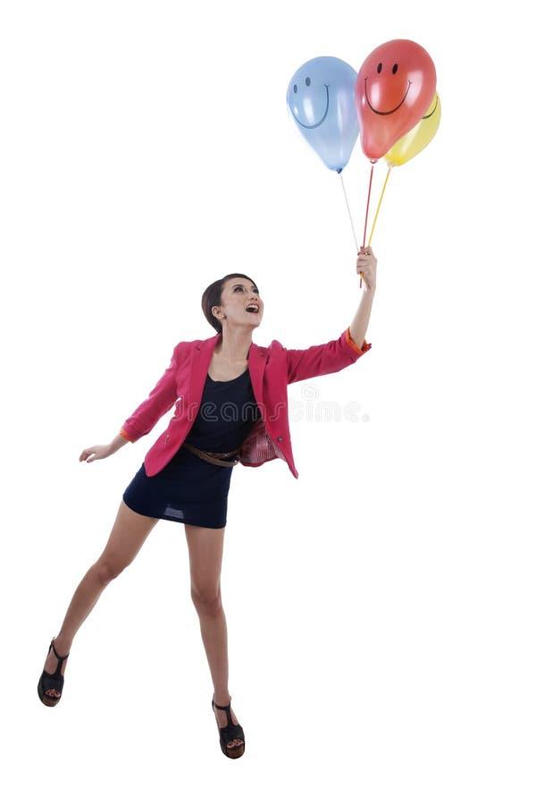 Empresaria feliz con los globos sonrientes de la cara imagenes de archivo