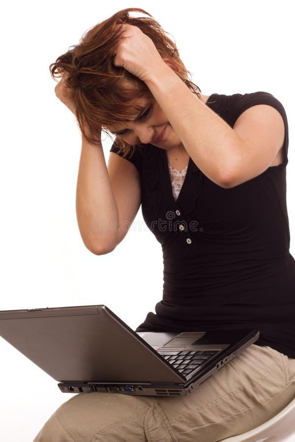 Empresaria frustrada que tira en su pelo imagenes de archivo
