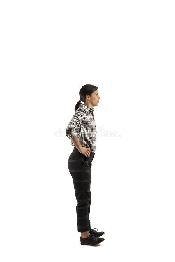 Empresaria joven aislada en el fondo blanco que hace ejercicios imágenes de archivo libres de regalías