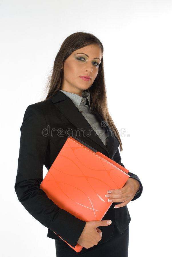 Empresaria joven con la carpeta anaranjada del fichero fotos de archivo