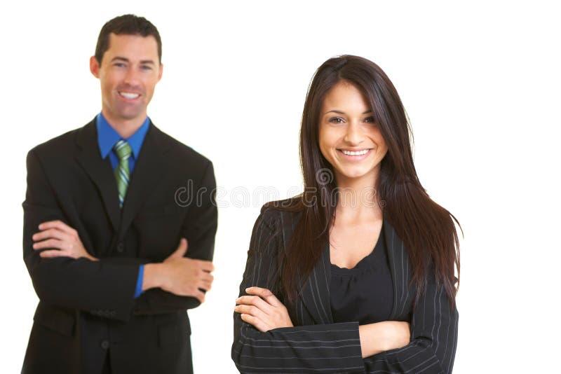 Empresaria joven confiada feliz con el colega masculino foto de archivo libre de regalías