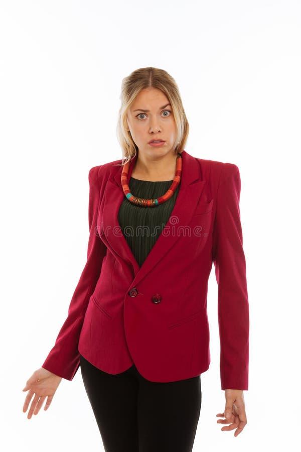 Empresaria joven hermosa que mira un pequeño confuso foto de archivo libre de regalías