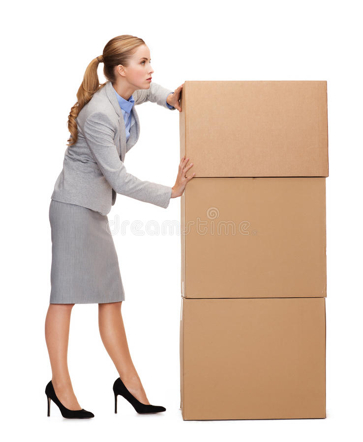Empresaria ocupada que empuja la torre de cartulinas imagen de archivo libre de regalías