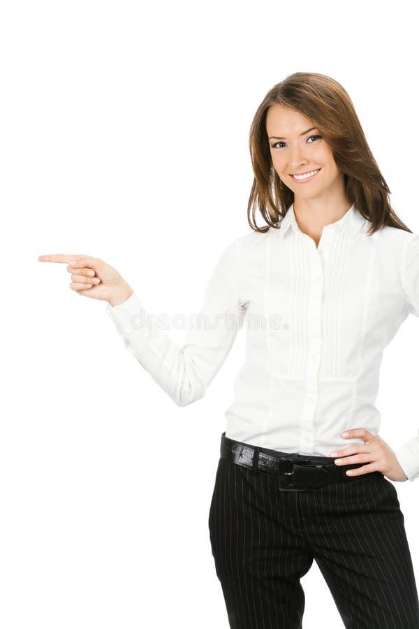 Empresaria que señala, en blanco fotografía de archivo