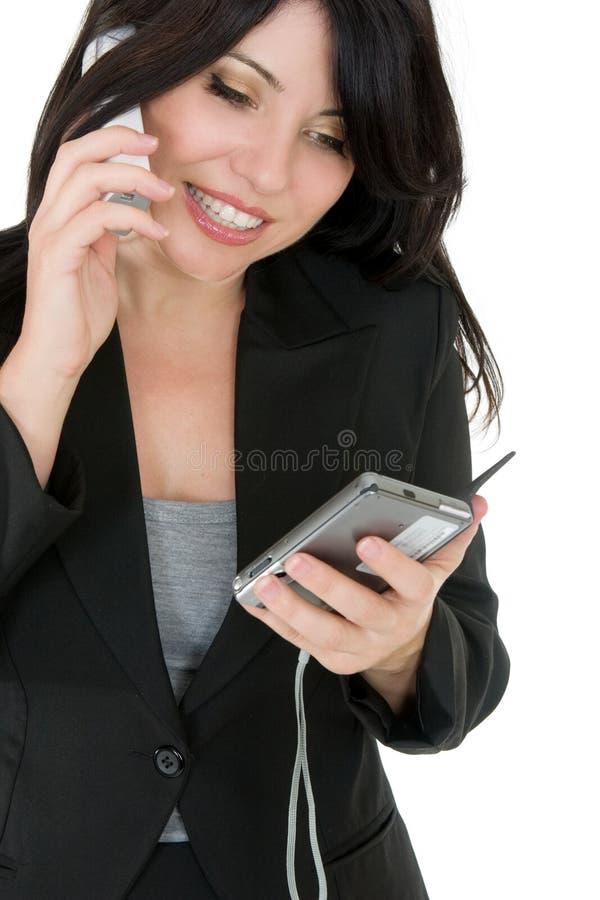 Empresaria que telefona a un cliente imagen de archivo libre de regalías