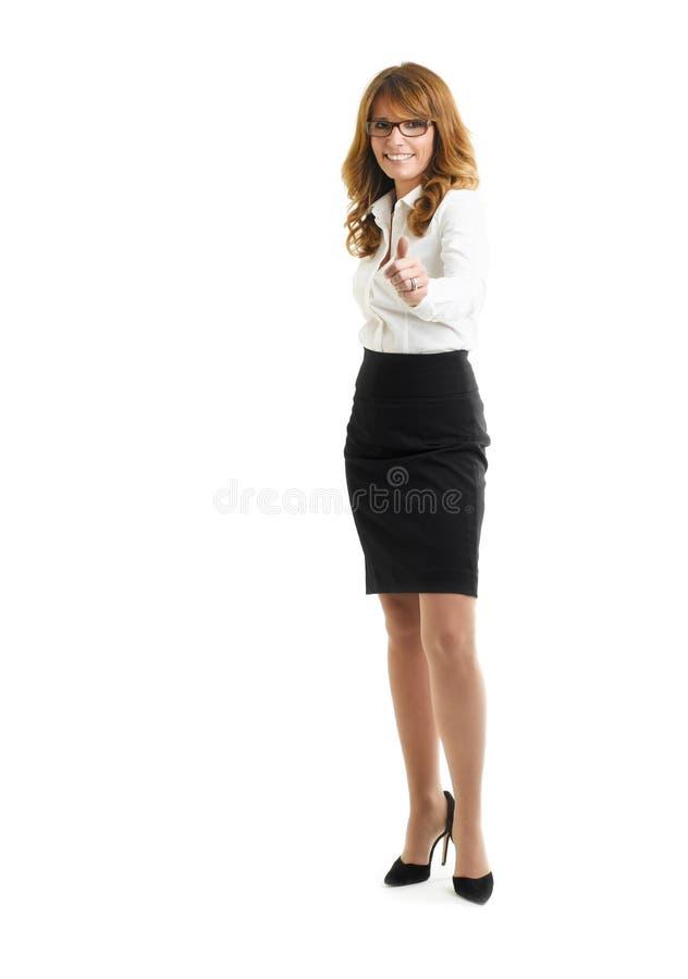Empresaria sonriente hermosa que muestra los pulgares para arriba fotos de archivo