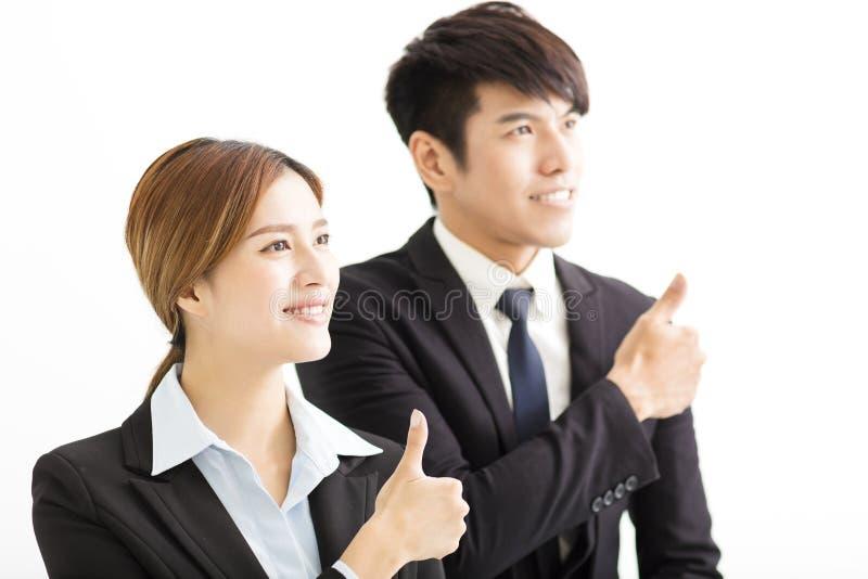 Empresaria y hombre de negocios sonrientes con los pulgares para arriba imágenes de archivo libres de regalías