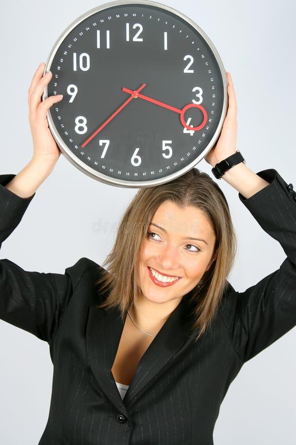 Empresaria y reloj imagen de archivo