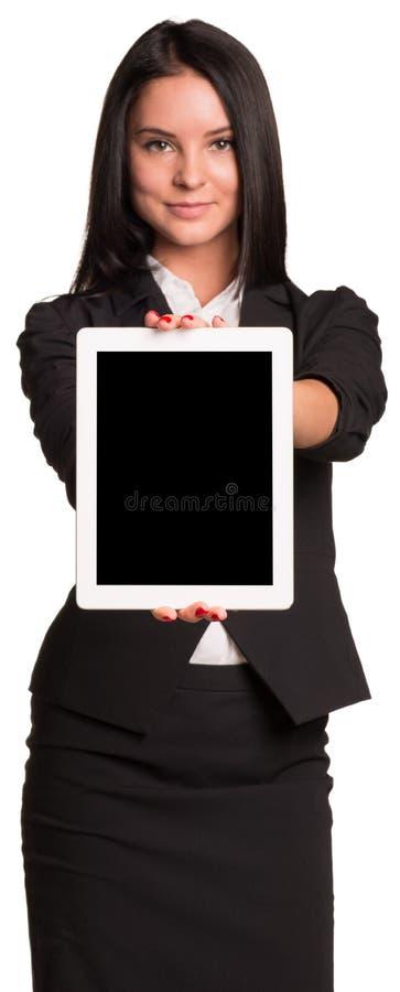 Empresarias hermosas en PC de la tableta de la demostración del traje foto de archivo libre de regalías