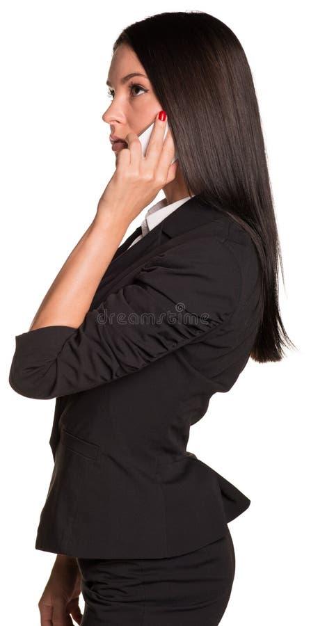 Empresarias hermosas en traje que hablan en el teléfono fotografía de archivo libre de regalías