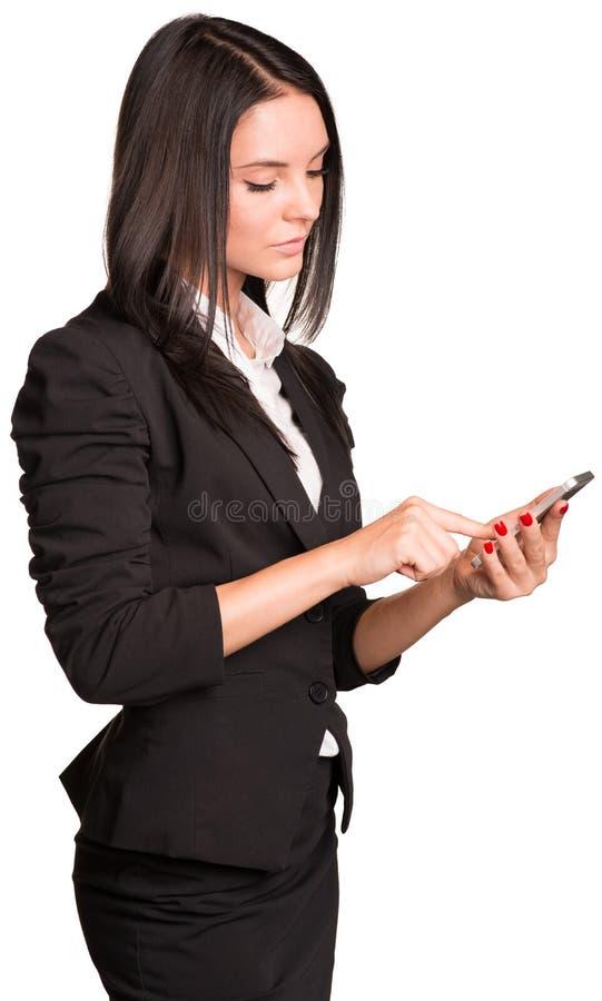Empresarias hermosas en traje usando el teléfono elegante imagenes de archivo