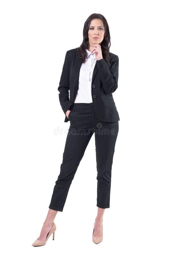 Empresario de negocio de sexo femenino acertado autoritario que mira la cámara fotografía de archivo libre de regalías