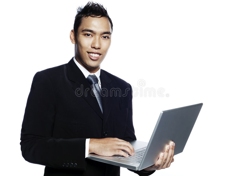 Empresario joven del malay con el ordenador portátil foto de archivo libre de regalías