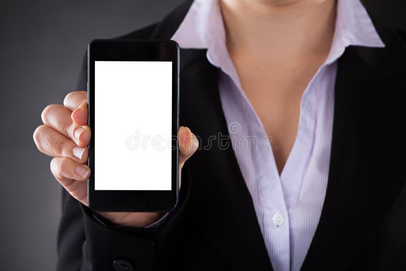 Empresario Showing Mobile Phone fotos de archivo libres de regalías