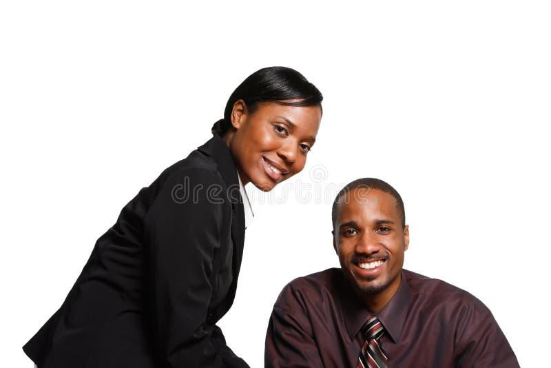 Empresarios sonrientes - horizontales imagen de archivo libre de regalías