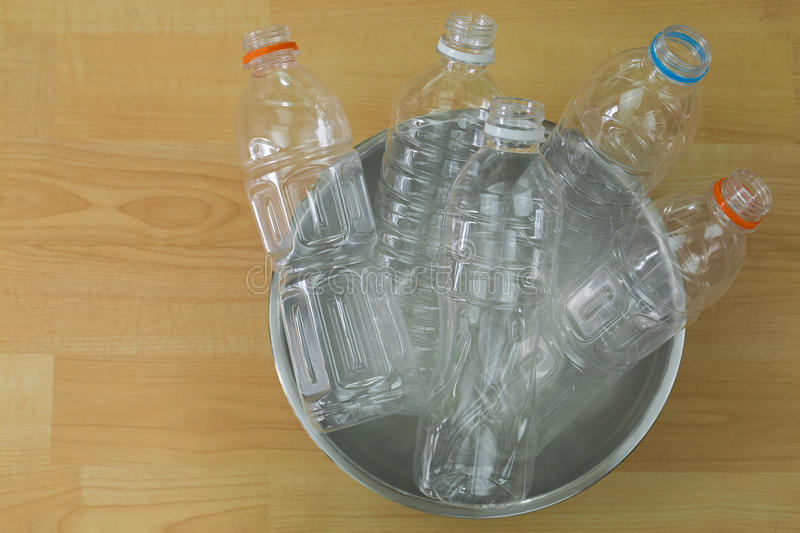 Emptied recyclable clear plastic mineral soda water bottles in a stock photo