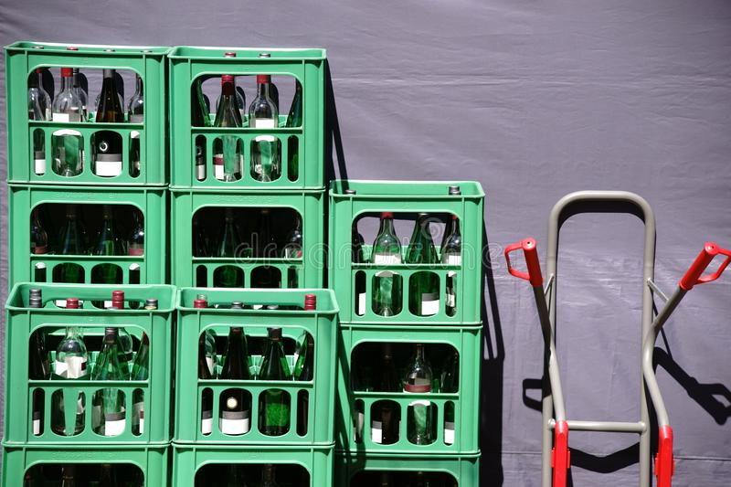 Empties behind the stall. Bottle crates with empties from wine bottles behind a stall at the market stock photos