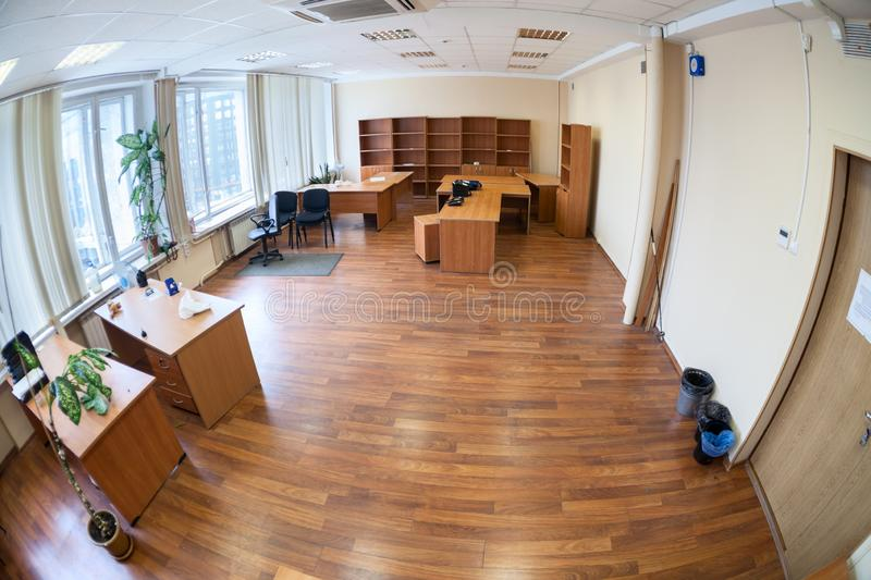 Empty abandoned office room with the remaining furniture, wide angle view. Empty office room with the remaining furniture, wide angle view royalty free stock photo