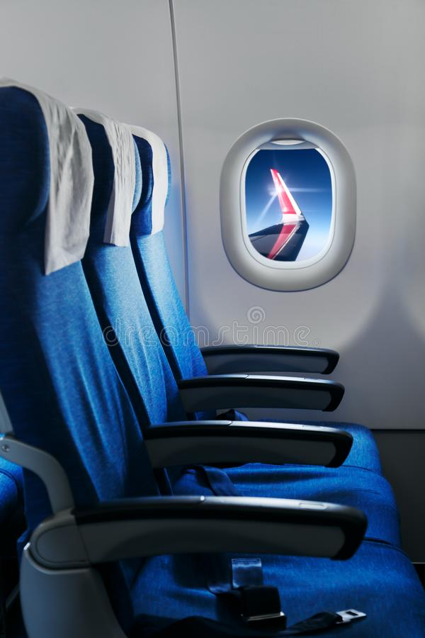 Empty air plane seats. Airplane interior royalty free stock image