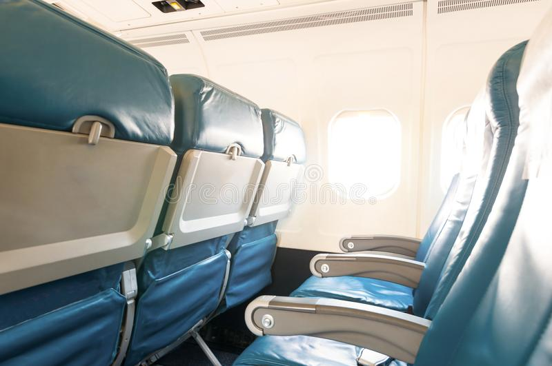 Empty aircraft seats and windows. Travel background stock photography