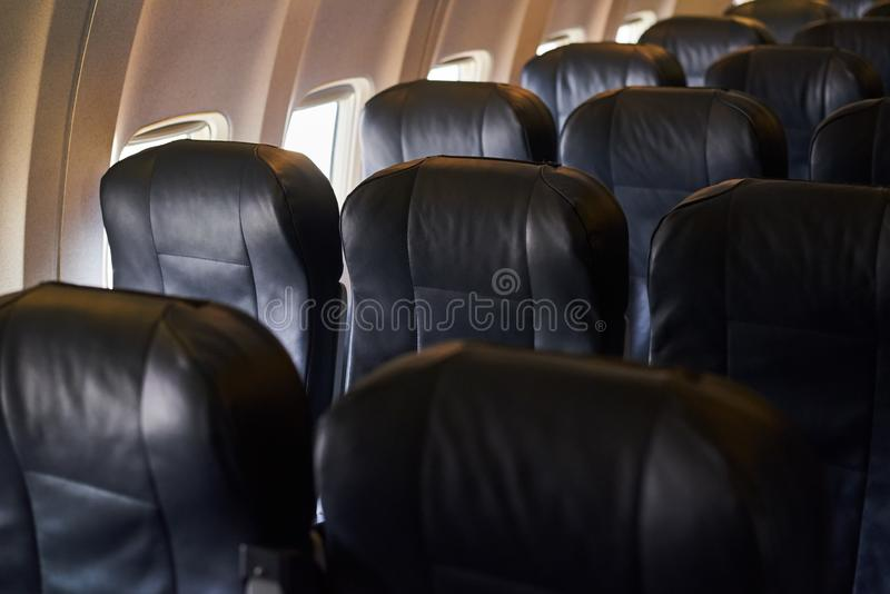 Empty airplane passenger seats in airplane. A plane interior royalty free stock photo