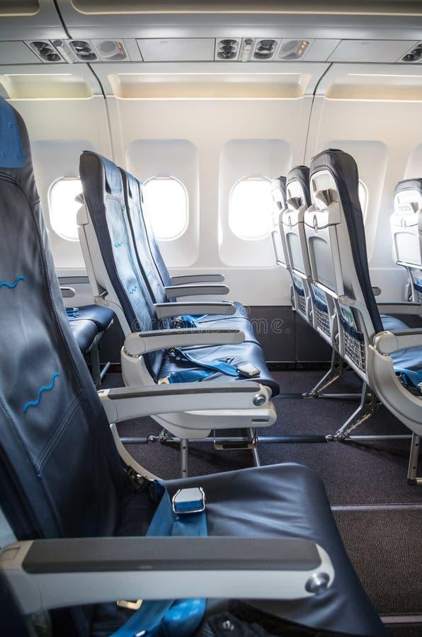 Empty airplane seats stock image