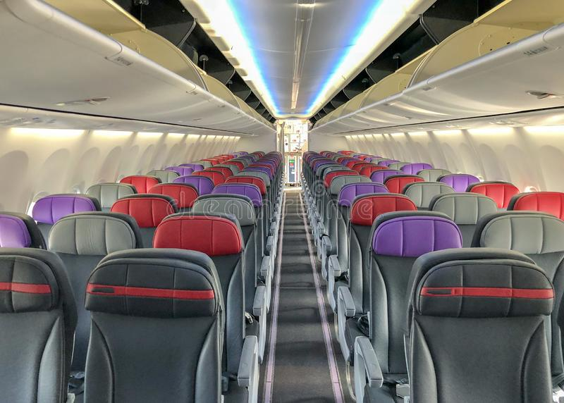 Empty airplane with seats and windows.  stock photography