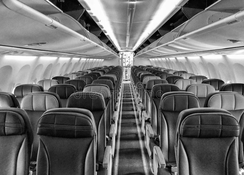 Empty airplane with seats and windows royalty free stock images