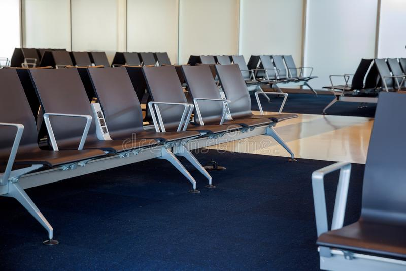 Empty airport departure lounge terminal waiting area with chair. Empty departure lounge airport terminal waiting area with chairs royalty free stock images