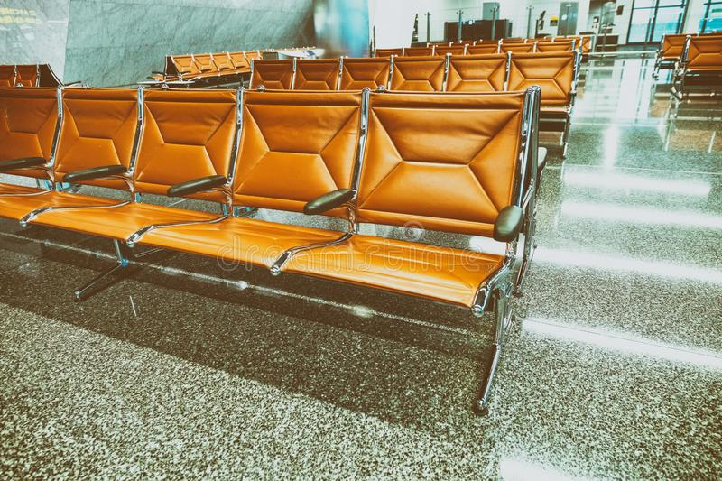 Empty airport terminal waiting area with chairs stock image