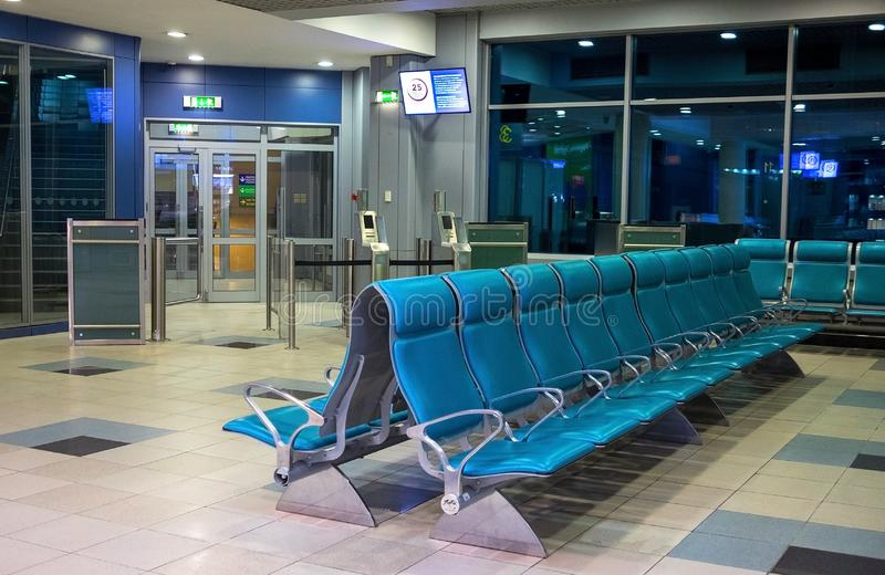 Empty airport terminal waiting area with chairs. Airport terminal waiting area with chairs stock photo