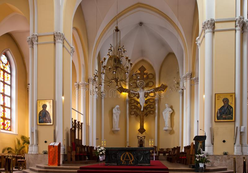 An empty altar of the Gothic cathedral between services, icons stock photography