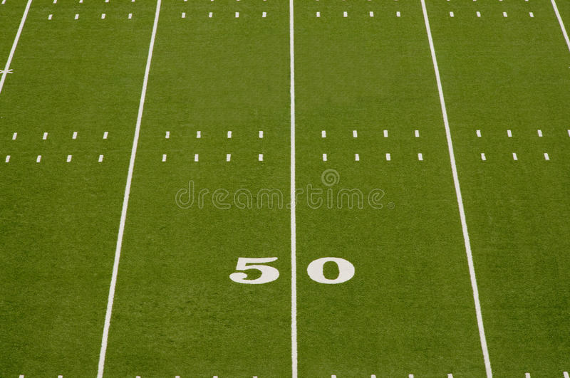 Empty American Football Field. Showing 50 yard line stock images