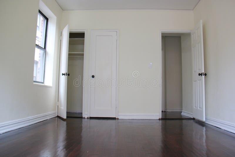 Empty apartment room with dark floors royalty free stock photos