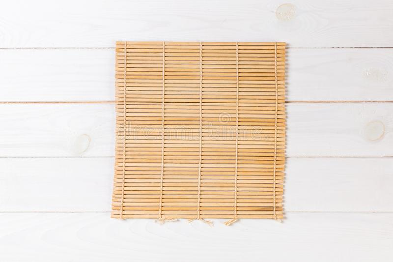 Empty Asian Food Background. brown Bamboo mat on wnite wooden background top view with copy space flat lay. Empty Asian Food Background. brown Bamboo mat on stock photography