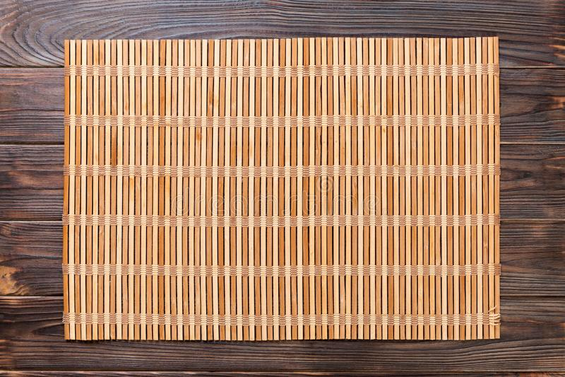 Empty Asian Food Background. brown Bamboo mat on wooden background top view with copy space flat lay.  stock photography