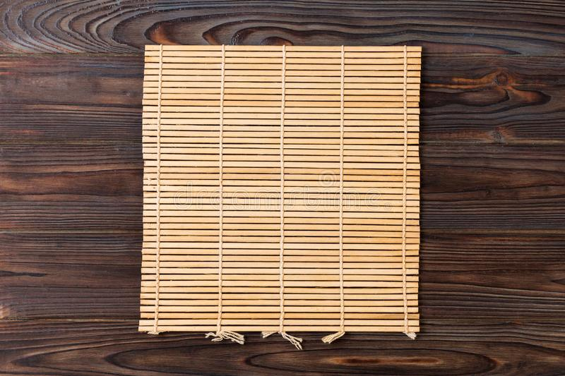 Empty Asian Food Background. brown Bamboo mat on wooden background top view with copy space flat lay.  stock photos