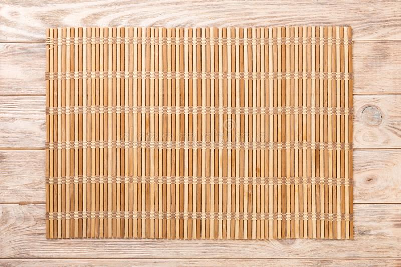 Empty Asian Food Background. brown Bamboo mat on wooden background top view with copy space flat lay.  royalty free stock image