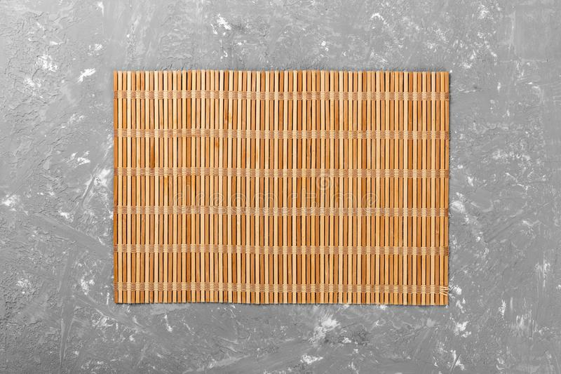 Empty Asian Food Background. brown Bamboo mat on wooden background top view with copy space flat lay.  stock photo