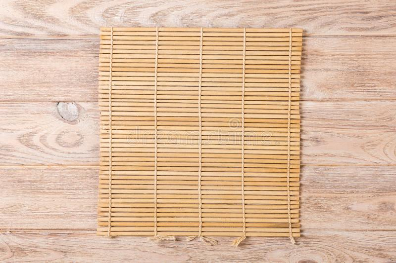 Empty Asian Food Background. brown Bamboo mat on wooden background top view with copy space flat lay.  royalty free stock images
