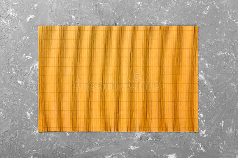 Empty Asian Food Background. Yellow Bamboo mat on wooden background top view with copy space flat lay.  stock photography