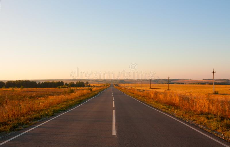 Empty asphalt road. Empty asfalt road to horizon at sunset stock image