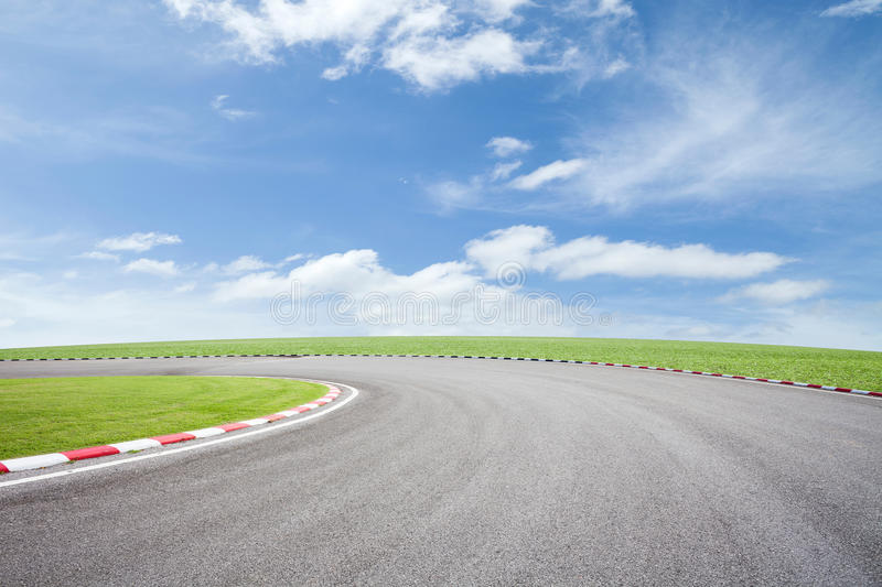 Empty asphalt road with green grass on sky background. Empty asphalt road with green grass on sky background royalty free stock image