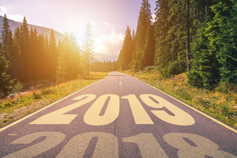 Empty asphalt road and New year 2019 concept. Driving on an empty road in the mountains to upcoming 2019 and leaving behind old 2 stock photos
