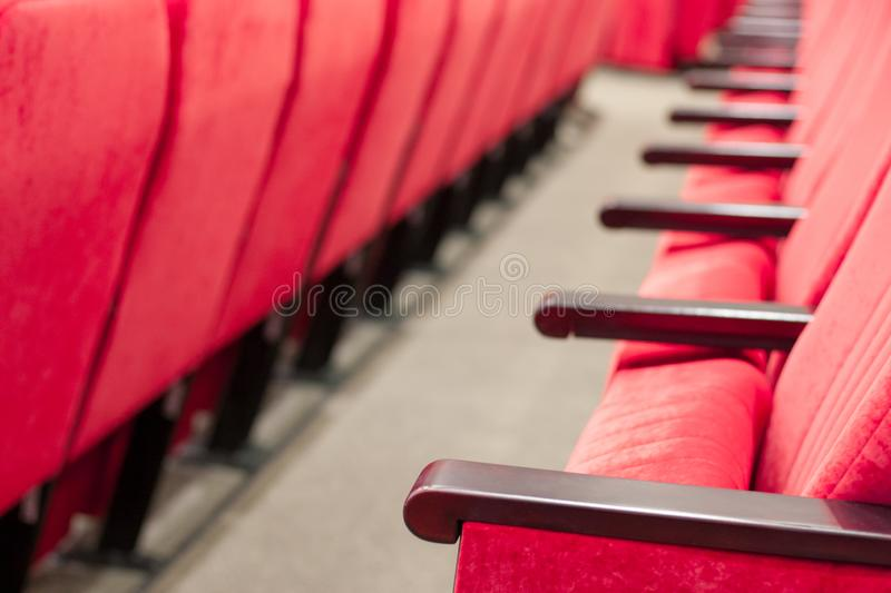 Empty assembly hall with red chairs in rows. concept of trainings, business meetings and conferences. For decor and design background texture royalty free stock image